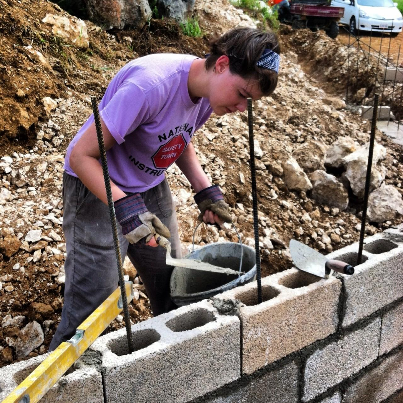 Sarah working on the wall.