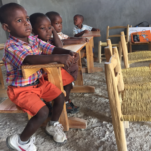 Kids in a classroom in Haiti.